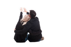 Rear view of young couple sitting down stock photos
