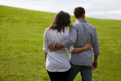 Rear view of young couple standing in park Stock Photo