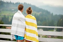 Rear view of young couple standing on terrace. stock image