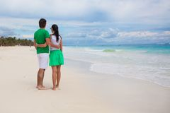 Rear view of Young couple walking on exotic beach Royalty Free Stock Photo