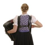 Rear view of young drindl woman playing accordion Royalty Free Stock Photos
