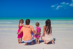 Rear view of young family with two kids on Royalty Free Stock Photography