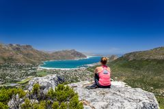 Rear view of young female hiker woman looking at Hout Bay near Cape Town stock photo
