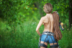 Rear view of young female rock climber. Stock Photos