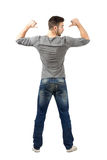 Rear view of young fit man pointing on shirt Royalty Free Stock Photos