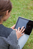 Rear view of a young girl using her tablet pc Royalty Free Stock Photo