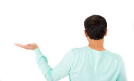 Rear view of young guy posing with arm outstretched Stock Image
