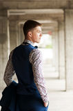 Rear view of a young handsome man in a flower shirt and vest. Royalty Free Stock Photos