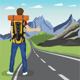 Rear view of young man doing hitchhiking on road in mountains. Rear view of young man doing hitchhiking on the road in mountains Stock Image