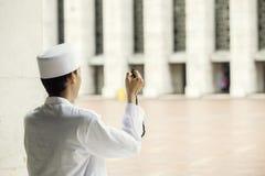 Muslim man prays to the Allah after doing Salat stock photography
