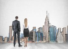 Businessman businesswoman looking at a city sketch stock image