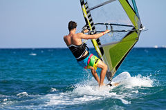 Rear view of young windsurfer Royalty Free Stock Images