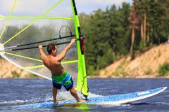 Rear view of young windsurfer close-up Stock Photo