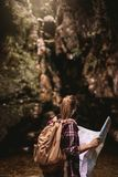 Female hiker with map looking away stock image