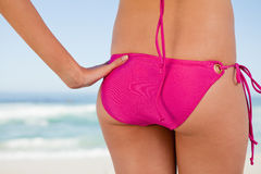 Rear view of a young woman body in pink swimsuit Stock Photography