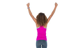 Rear view of young woman cheering with arms raised Royalty Free Stock Photography