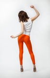 Rear view of young woman dancing. Full length Stock Photo