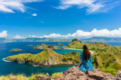 Young woman enjoying the awesome view of Padar Island during summer vacation Royalty Free Stock Image