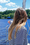 Rear view of a young woman enjoying sailing on a yacht Royalty Free Stock Photography