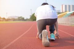 Rear view of young woman get ready to run on track royalty free stock photos