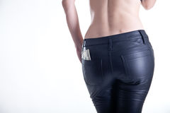 Rear view of young woman in leather pants Stock Photos