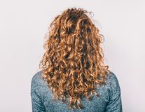 Rear view of young woman with long hair stock images