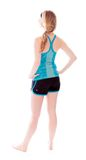 Rear view of a young woman standing with her arms akimbo Royalty Free Stock Photography