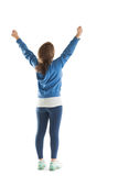Rear view of young woman stretching her hands Royalty Free Stock Images