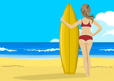 Rear view of young woman with surfboard looking into the distance Stock Image