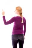 Rear view of a young woman using imagery virtual screen Royalty Free Stock Photo