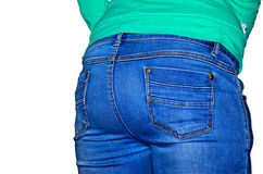 Rear view of young woman wearing blue jeans. Rear view of the young woman wearing blue jeans Royalty Free Stock Image