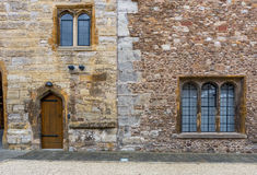 Rear wall of the castle. It is interesting how small is the door and how large are the windows Royalty Free Stock Photo