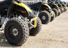 Rear wheel of all-terrain vehicle arranged in row. An all-terrain vehicle (ATV), also known as a quad Royalty Free Stock Images