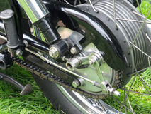 Rear wheel of a black vintage motorcycle. With tyre, chain and brake drum Stock Image