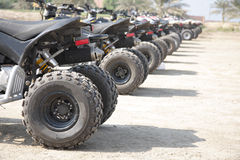 Rear wheel of desert sscooter arranged in a row Royalty Free Stock Images