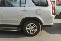 Rear wheel of hatchback car in closed up wheel on traffic backg stock images