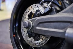 The rear wheel of a modern motorcycle royalty free stock images