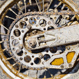 Rear wheel of motorcycle with chain Royalty Free Stock Images