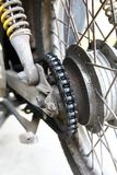 The Rear Wheel of a Motorcycle with a Dirty Chain. Close Up Royalty Free Stock Photos
