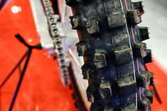 The rear wheel of a motorcycle stock image