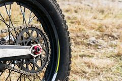 Rear wheel motorcycle trial and enduro. Mounted on the wheel gear and chain with spokes Stock Photography
