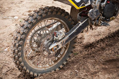 Rear wheel of sport bike. Dirty road Stock Photo