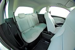 Rear white seats in a small car stock photos