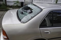 Rear windscreen of the case was badly smashed. Smashed rear windscreen of the car Royalty Free Stock Photo