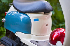 Rear wing and headlight of blue retro scooter.  Royalty Free Stock Photos