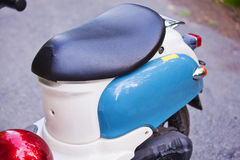 Rear wing and headlight of blue retro scooter.  Royalty Free Stock Photography