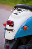 Rear wing and headlight of blue retro scooter stock photography