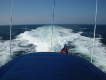 Rear of yacht and wake. Details of yacht aft or rear with wake in background royalty free stock photography