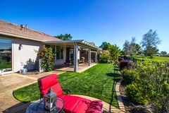 Rear Yard Patio Of Modern Home. Rear Yard Patio With Lawn Furniture & Grass On Modern Home Stock Images
