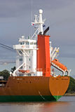 RearCargo. Rear of Cargo Ship showing lifeboat escape vessel on launcher Royalty Free Stock Photos